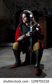 Portrait of Brave Knight With Sword Against Stonewall