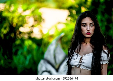 Portrait of Brazilian female model, brunette, hair and dark eyes, posing outdoors