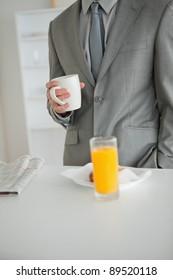 Portrait of a breakfast taken by a businessman in his kitchen