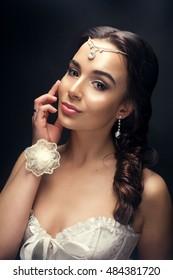 Portrait of a bride brunette. Studio shot