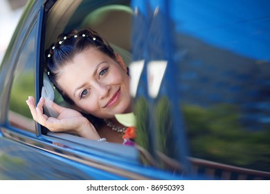 portrait of the bride in the car