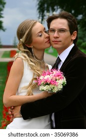 portrait of the bride and groom against summer landscape