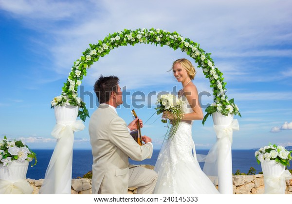 portrait of a bride and groom in a greek island on their wedding day