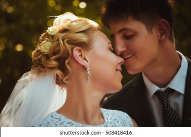 portrait of the bride and groom on the forest background.