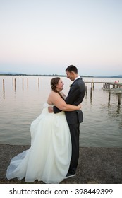 Portrait of a bride and groom on their wedding day at a yacht club marina in Oregon.