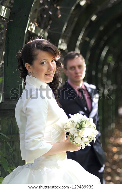 Portrait of bride and groom in park