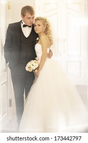 portrait of the bride and groom at a wedding in a beautiful house