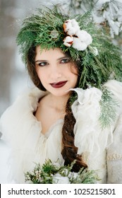 Portrait of a bride in a red dress. Winter Wedding Ceremony