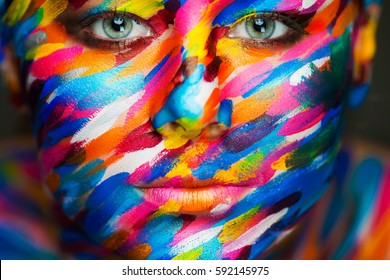 Portrait of the bright beautiful emotional woman with art make-up