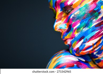 Portrait of the bright beautiful young woman with art make-up