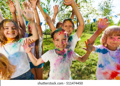 Portrait of bright kids smeared in colored powder