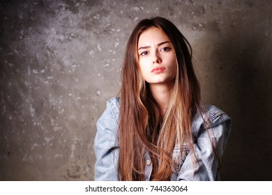 Portrait of a bright young arrogant woman model fashion look girl