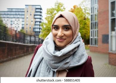 Portrait Of British Muslim Woman In Urban Environment