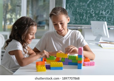 Portrait of brother and sister playing with colorful plastic blocks together