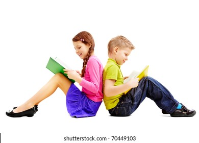 Portrait of brother and sister sitting back to back and reading books