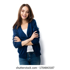 Portrait of brunette lovely woman in casual smart blue clothing with crossed arms, isolated against white background. Emoshions and feeling concept studio shoot.