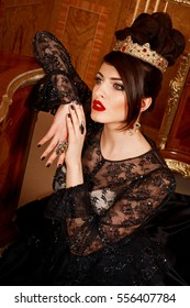 Portrait of a brunette in a luxurious evening dress with beautiful hairstyle