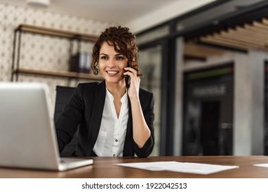 Portrait of brunette smiling woman, work station.