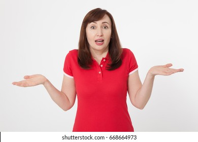 Portrait of brunette surprised happy woman in blank red t-shirt with copy space on white background. Mock up. Menopause