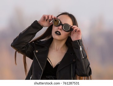 portrait of a brunette with vintage glasses