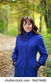 Portrait of brunette woman in autumn park