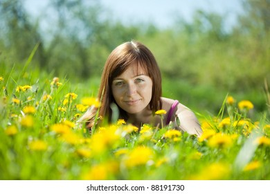 Portrait of brunette woman in green grass