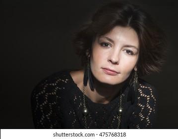 Portrait of a brunette woman on dark background