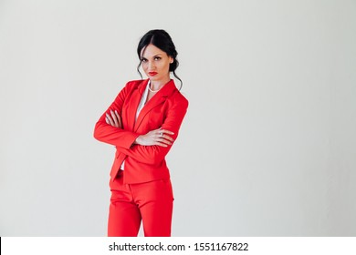 Portrait of a brunette woman in a red business suit in the office