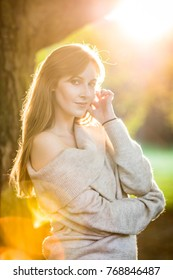 portrait of a brunette young independent happy woman in autumn park happy thoughtful spring autumn mood at golden hour