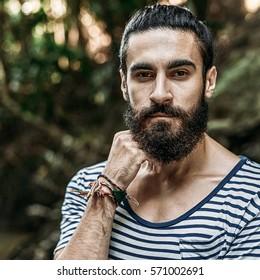 Portrait of a brutal bearded man