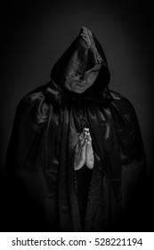 Portrait of a brutal man in a black robe