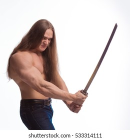Portrait of a brutal man bodybuilder with bare-chested with long hair with a Japanese sword on a white background