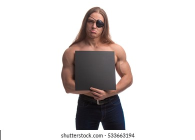 Portrait of a brutal man bodybuilder with a black label with long hair with a black sheet of paper for notes in the hands on a white background