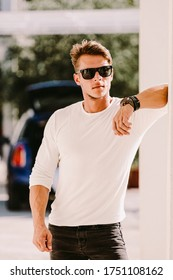 portrait of a brutal man in sunglasses and watch outdoors. Stylish man wearing casual. Men's beauty, fashion. Optics for men.