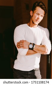 portrait of a brutal man in white wearing watch  and accessories outdoors. Stylish man wearing casual. Men's beauty, fashion.
