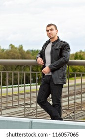 portrait of the brutal young sexual man in a leather jacket