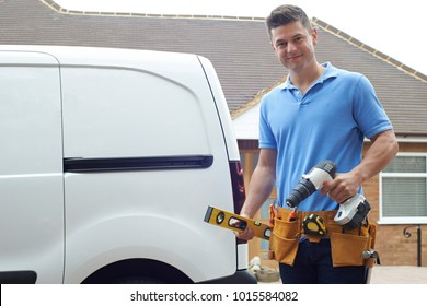 Portrait Of Builder With Van Outside House