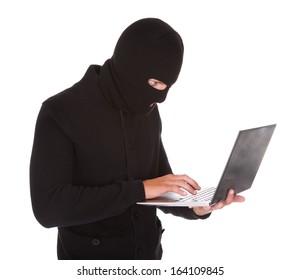 Portrait Of A Burglar Using Laptop Isolated On White Background
