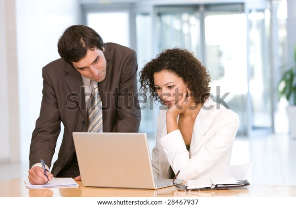 Portrait of business colleagues working on laptop