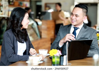 portrait of business couple meeting during coffee break at coffee shop