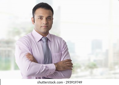 Portrait of business executive with arms folded