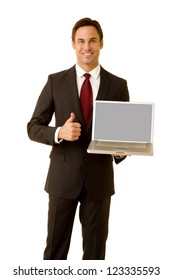 Portrait of a business executive on a white background holding a laptop computer giving the thumbs up sign