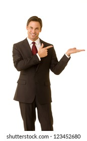 Portrait of a business executive pointing and extending his hand ready to place a product.