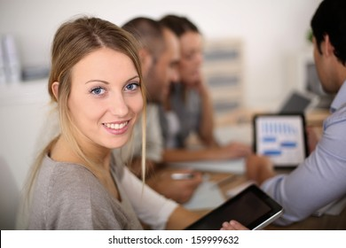 Portrait of business girl attending meeting