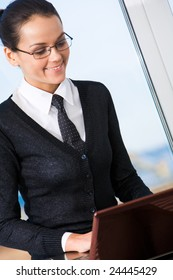 Portrait of business lady typing documents in office