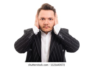 Portrait of business man covering ears like deaf concept isolated on white background with copyspace advertising area