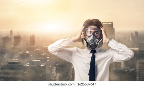 Portrait business man with gas mask he serious problem dust smog in the city, Asian man worrying about the problem Coronavirus disease (COVID-19)