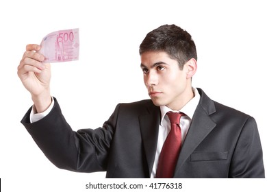 Portrait of a business man holding money isolated on white background