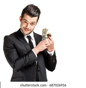 Portrait of a business man holding money, isolated on white