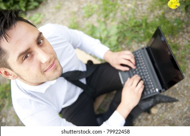 Portrait of a business man with laptop